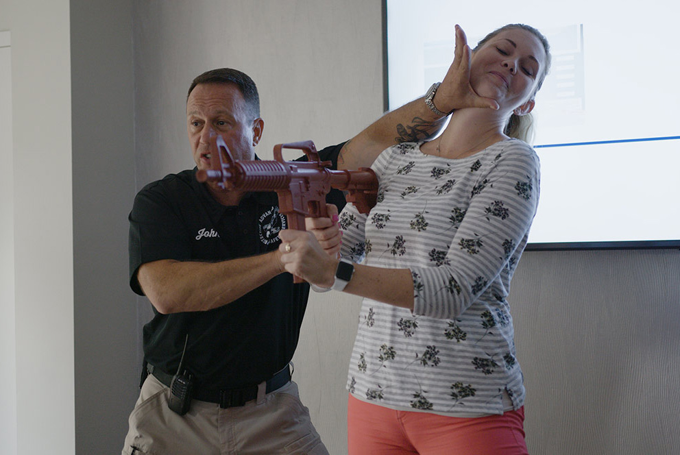While fighting is the last resort in the Run-Hide-Fight strategy, John Nettis from PASS demonstrates techniques with Amanda Moyer, director of account services at Market Mentors.